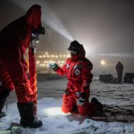 MOSAiC team members conduct fieldwork on Arctic ice