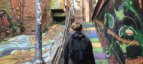 Valparaíso is famous for its crazy street art. Here Izzy is going up one of the many beautiful staircases that crisscross the city.