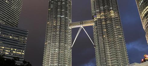 Petronas Twin Towers with fountain show at night