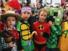 Look at their faces! They were so ready to see who won the costume contest