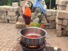 This is one of the other homestay moms cooking a delicious dish of redred.