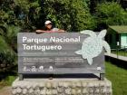 The Tortuguero National Park sign in the village