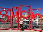 Me standing next to the city sign of the coastal city of Gijón