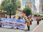 Indigenous men march to support Evo Morales