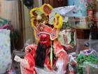 A traditional puppet you might see inside of a temple