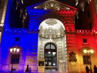 The Justice Palace in Paris illuminated with the French flag's colors