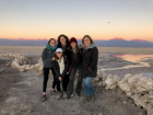 The sun setting in the desert behind me with some friends I met here in Chile