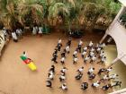 Students in school celebrate Cameroon at a daily march with the flag and every school has a dress code