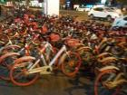 Hordes of available bicycles on the sidewalk for anyone to use