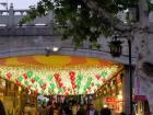 """At one of the many famous """"eat streets,"""" both sides of the street lined with street food merchants and shops"""