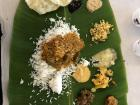 A traditional South Indian meal of rice and various sauces/flavoring, served on a banana leaf