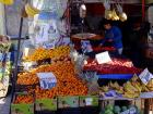 Street vendors sell fruit, vegetables and other items in the city center