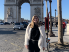 A photo of me in front of L'arc de Triomphe