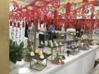 A beautiful display of treats and Chinese paper cutouts for the Mid-Autumn Festival